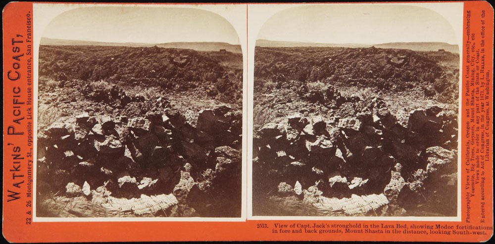 Watkins #2513 - View of Capt. Jack's stronghold in the Lava Bed, showing Modoc fortification in fore and back grounds. Mount Shasta in the distance, looking South-west.