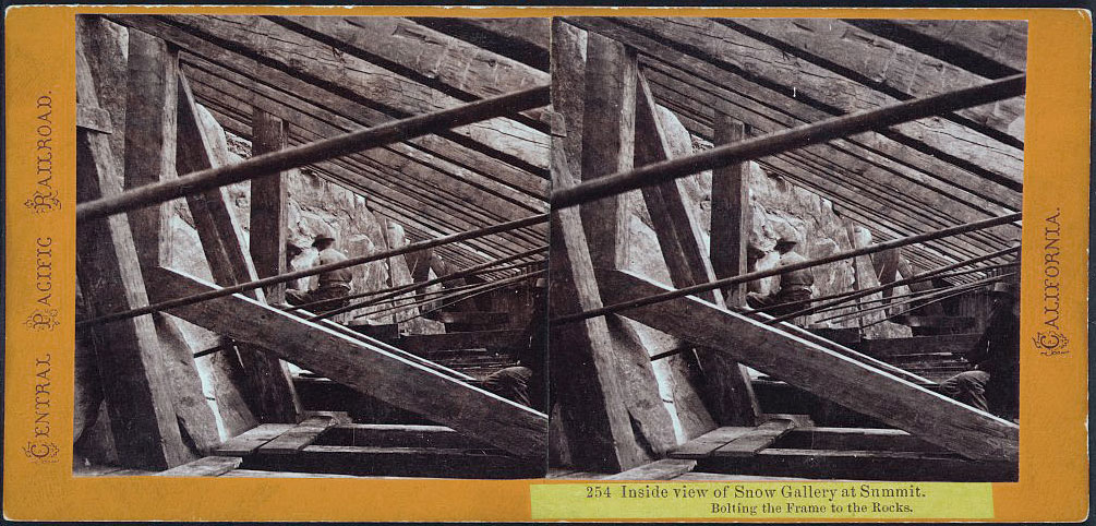 Watkins #254 - Inside view of Snow Gallery at Summit. Bolting the Frame to the Rocks