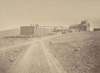 #1315 - Contention Hoisting Works and Ore Dump, from below, Arizona Territory